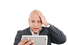 Photo 300 DPI: Shocked young business man with tablet on white