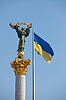 Photo 300 DPI: Independence monument and ukrainian flag in Kiev,