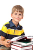 Schoolboy sitting with books | Stock Foto