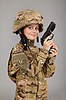 Young boy dressed like soldier with gun | Stock Foto
