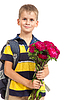 Schoolboy hält Blumen. Back to school | Stock Photo