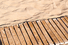 모래에 풍 나무 판자   Stock Foto