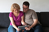 Photo 300 DPI: Middle-aged couple with digital tablet pc