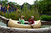 Photo 300 DPI: Two boys paddling in their canoe at Legoland