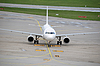 Airplane taxiing at large airport | Stock Foto
