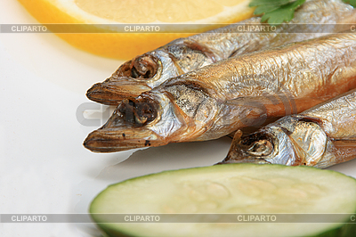 Smoked fishes with lemon, cucumber and green parsley | High resolution stock photo |ID 3032658