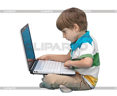 Boy with laptop isolated on white | High resolution stock photo |ID 3013838