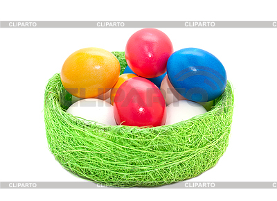Easter eggs in wicker basket | High resolution stock photo |ID 3014593