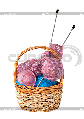 Yarn for knitting with knitting needles in wicker basket | High resolution stock photo |ID 3019265