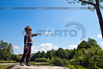 Little boy said pointing at the sky | High resolution stock photo |ID 3024428