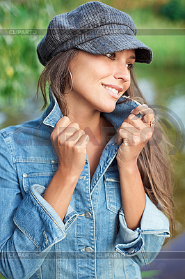 Attractive young woman dressed in jean jacket and beret   High resolution stock photo  ID 3016799