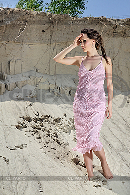 Beautiful young woman standing barefoot in sand | High resolution stock photo |ID 3016847