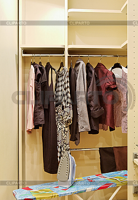 Wardrobe with clothes and ironing board | High resolution stock photo |ID 3016945