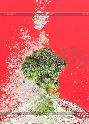 Green broccoli falling in water with air bubbles | High resolution stock photo |ID 3017024