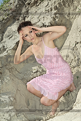 Lady in pink scaly sundress on sand quarry | High resolution stock photo |ID 3017123