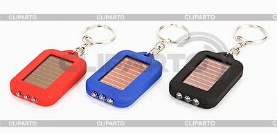 Drei kleine Schmuckstück mit LED Taschenlampe | Foto mit hoher Auflösung |ID 3017190