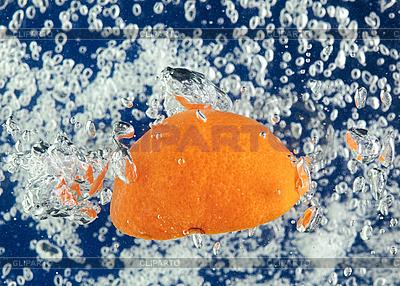 Orange (mandarin) floating in blue water | High resolution stock photo |ID 3024493