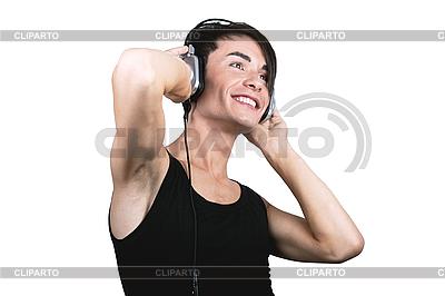 Молодой человек слушает музыку | Фото большого размера |ID 3095379