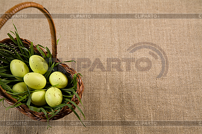 Basket with Easter eggs in grass | High resolution stock photo |ID 3020503