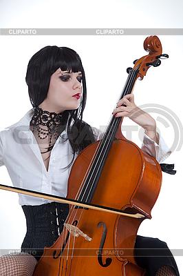 Atrakcyjna dziewczyna gra na wiolonczeli | Foto stockowe wysokiej rozdzielczości |ID 3020516