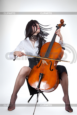 Sensual girl playing cello and moving her hair | High resolution stock photo |ID 3020517