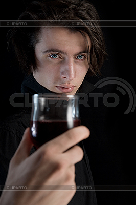 Handsome vampire holding glass of wine or blood | High resolution stock photo |ID 3022261