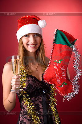 Smiling girl with Christmas stocking  | High resolution stock photo |ID 3022438