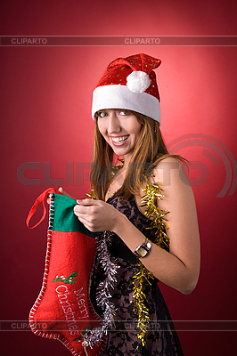 Happy girl with Christmas stocking  | High resolution stock photo |ID 3022442