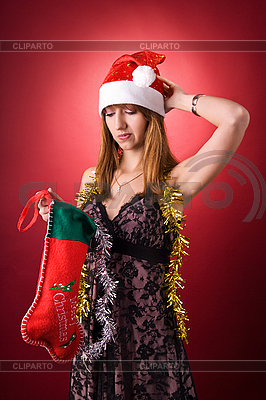 Disappointed girl with Christmas stocking  | High resolution stock photo |ID 3022443