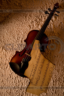 Old violin with burnt music sheet  | High resolution stock photo |ID 3022598
