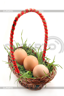 Basket with grass and eggs  | High resolution stock photo |ID 3023271