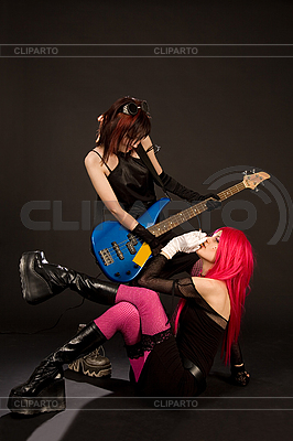 Sexy rock girls with bass guitar | High resolution stock photo |ID 3023367