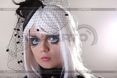 Portrait of young woman wearing blue contact lenses  | High resolution stock photo |ID 3059425
