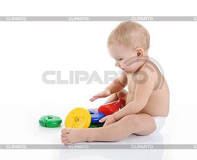 Szczęśliwe dziecko z zabawkami | Foto stockowe wysokiej rozdzielczości |ID 3021646