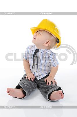 Happy child in yellow builder helmet | High resolution stock photo |ID 3021653
