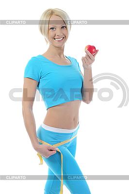 젊은 체육 여성의 허리를 측정합니다. | 높은 해상도 사진 |ID 3021660