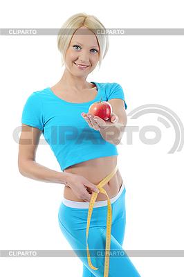 젊은 체육 여성의 허리를 측정 | 높은 해상도 사진 |ID 3021661
