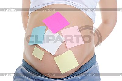 Notizpapiere auf Bauch einer schwangeren Frauen | Foto mit hoher Auflösung |ID 3021719
