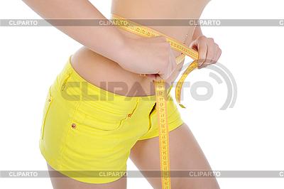 Młoda kobieta sportowe pomiaru talii | Foto stockowe wysokiej rozdzielczości |ID 3021873