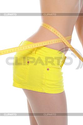 Junge athletische Frau messt Taille | Foto mit hoher Auflösung |ID 3021874