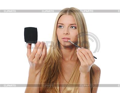 Piękna kobieta robi makijaż   Foto stockowe wysokiej rozdzielczości  ID 3021884