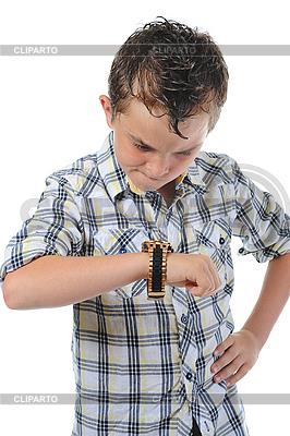 Chłopiec obserwując czas | Foto stockowe wysokiej rozdzielczości |ID 3021958