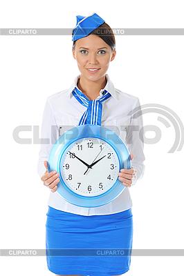 Atrakcyjna stewardesa z zegarem   Foto stockowe wysokiej rozdzielczości  ID 3021992