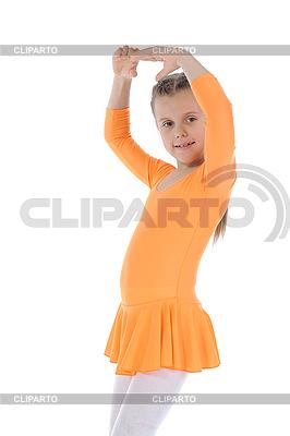 Kleine Ballerina tanzt im orangefarbenen Kleid. | Foto mit hoher Auflösung |ID 3022027