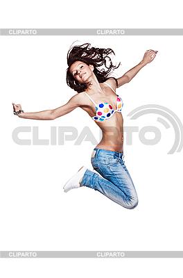Glückliche junge Frau springt | Foto mit hoher Auflösung |ID 3023102