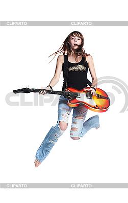 Piękne rock-n-roll jumping dziewczyna z gitarą | Foto stockowe wysokiej rozdzielczości |ID 3023866