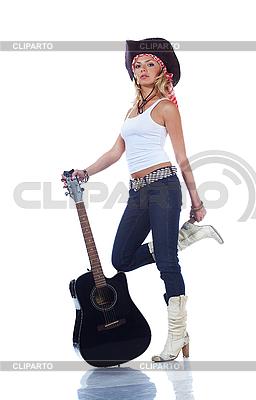 Cow-girl que sostiene una guitarra acústica | Foto de alta resolución |ID 3024240