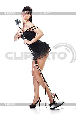 검은 드레스를 입고 섹시한 여성 가수 | 높은 해상도 사진 |ID 3024275