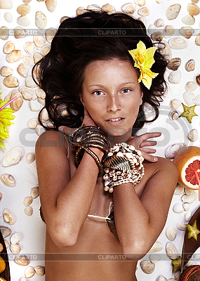 Beautiful exotic girl with Hawaiian accessories | High resolution stock photo |ID 3024280