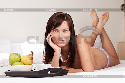 Young beautiful woman having breakfast lying on white bed  | High resolution stock photo |ID 3024302